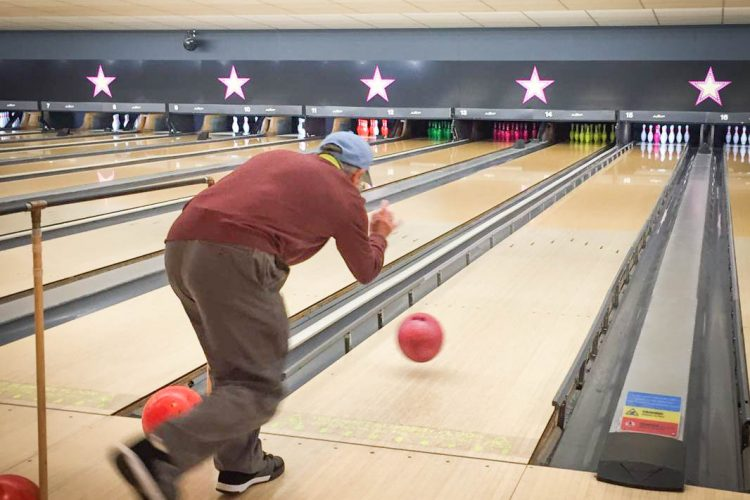 Action shot of a man throwing a bowling ball