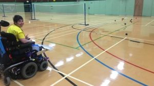 Rachel on the boccia court giving thumbs up to the camera